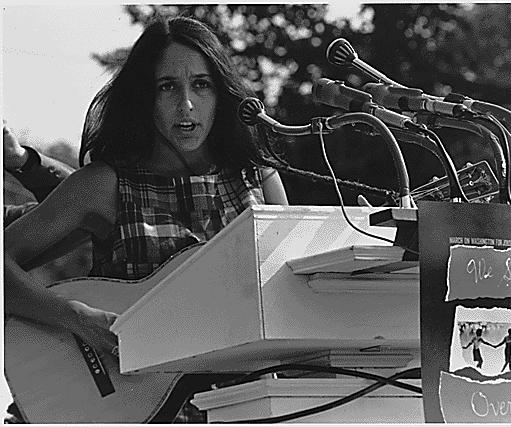 "Civil Rights March on Washington, D.C. [Entertainment: Vocalist Joan Baez. A sign hanging near the microphones reads ""We Shall Overcome."" ], 08/28/1963 photo by flickr http://www.flickr.com/photos/usnationalarchives/6053190883/in/set-72157627456510830/"